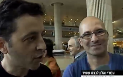 Alon, left, and Omri Lanchet-Shapir arrived at Ben Gurion Airport Friday with their newborn son, Shai (photo credit: screenshot Channel 2)