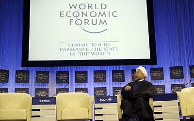 Iranian President Hassan Rouhani listening to the welcome remarks during a session of the World Economic Forum in Davos, Switzerland, Thursday, Jan. 23, 2014. (photo credit: AP Photo/Michel Euler)