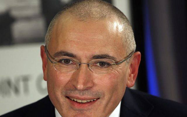 Mikhail Khodorkovsky speaks during a news conference in Berlin, December 22, 2013. (Photo credit: AP/Michael Sohn, File)