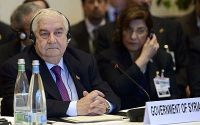 Syrian Foreign Minister Walid Moallem attends the Geneva II peace talks on Syria in Montreux, Switzerland, on January 22, 2014. (photo credit: AP/Keystone/Martial Trezzini)