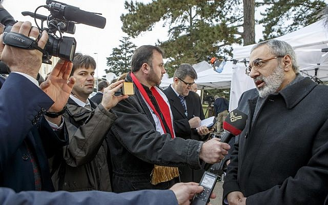 Syrian Information Minister Omran al-Zoubi speaks to the press before at the European headquarters of the United Nations, in Geneva, Switzerland, Saturday, Jan. 25, 2014 (photo credit: AP/Keystone,Salvatore Di Nolfi)