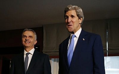 US Secretary of State John Kerry, right, poses with Swiss President Didier Burkhalter for photographers in Davos, Switzerland, Friday, Jan. 24, 2014. (photo credit: AP/Gary Cameron)