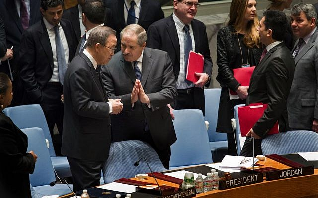 Jordanian Foreign Minister and President of the United Nations Security Council Nasser Judeh, right, has a conversation with UN Secretary General Ban Ki-moon as a Security Council meeting began at UN headquarters on Monday, January 20, 2014. (photo credit: AP/Craig Ruttle)