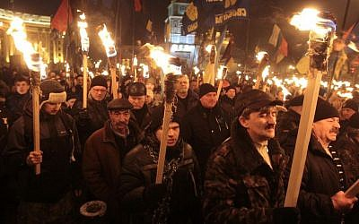 Ukrainian nationalists carry torches during a rally in downtown Kiev, Ukraine, early January. (photo credit: AP/Sergei Chuzavkov)