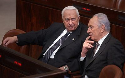Ariel Sharon, left, with Shimon Peres in the Knesset in 2005. (photo credit: Sharon Perry/Flash90)