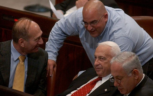 In the Knesset in October 2004 (from left):  Ehud Olmert, Omri Sharon, Ariel Sharon and Benjamin Netanyahu (Photo credit: Sharon Perry/Flash90)