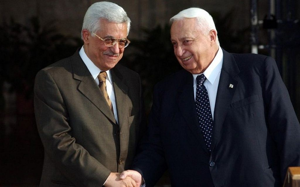 Ariel Sharon with Mahmoud Abbas at the Prime Minister's Office on July 01, 2003. (Photo credit: Nati Shohat Flash90)