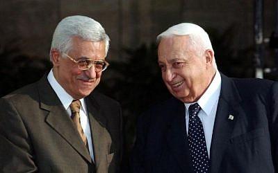 Ariel Sharon, right, and Mahmoud Abbas in 2003 (photo credit: Nati Shohat/Flash90)