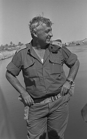 Maj. Gen. Sharon, standing alongside the Suez Canal during the Yom Kippur War (Photo credit: GPO/ Flash 90)