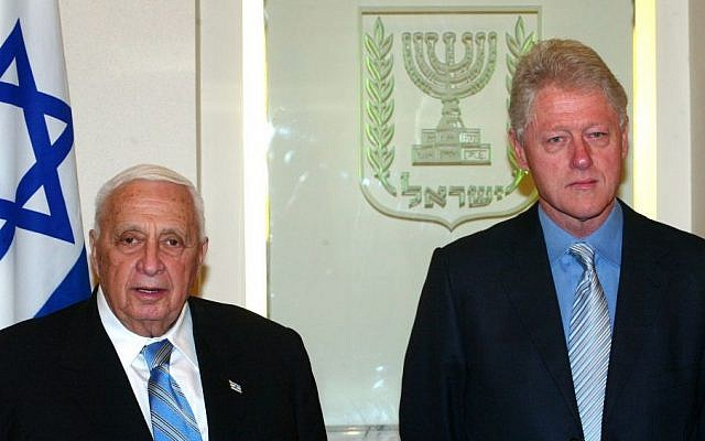 Former United States president Bill Clinton with former Israeli prime minister Ariel Sharon during a meeting at the prime minister's office in Jerusalem in 2005. (Photo credit: Flash90)