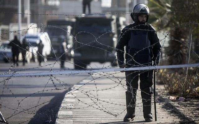 Illustrative photo of Egyptian riot police stand guard in Cairo, January 28, 2014. (AFP/Mahmoud Khaled)