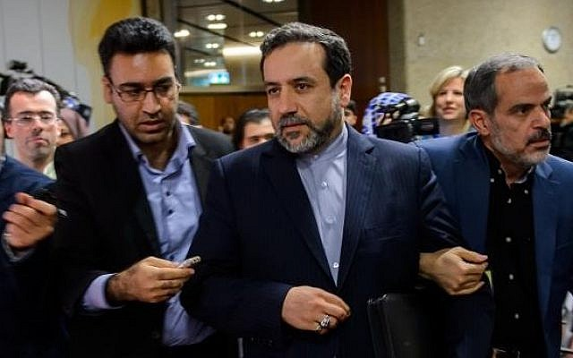 Iran's Deputy Foreign Minister Abbas Araqchi (C) is surrounded by journalists following a press conference on November 10, 2013, in Geneva. (AFP/File Fabrice Coffrini)