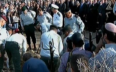 IDF major generals lay former premier Ariel Sharon in his grave in a military burial at Sharon's western Negev Sycamore Farm, January 13, 2014. (photo credit: screen shot/Channel 2)