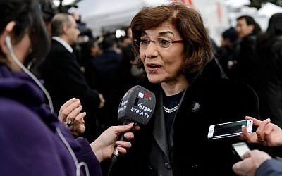 Syrian senior presidential advisor Buthaina Shaaban speaks to a Syrian TV reporter at the United Nations Offices in Geneva, on January 26, 2014. (Fabrice Coffrini/AFP)