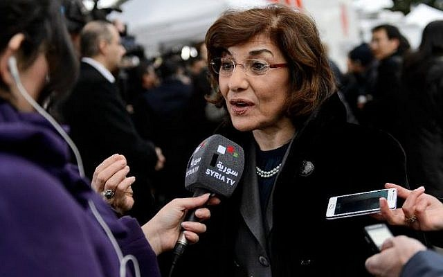 Syrian senior presidential advisor Buthaina Shaaban speaks to a Syrian TV reporter at the United Nations Offices in Geneva, on January 26, 2014 Photo credit: (Fabrice Coffrini/AFP)