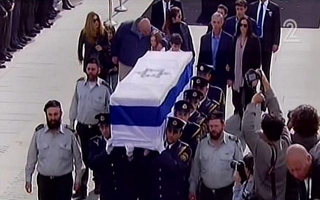 The casket of former premier Ariel Sharon is carried out of the Knesset plaza on Monday morning, January 13, 2014, after a memorial ceremony. (photo credit: screen shot/Channel 2)