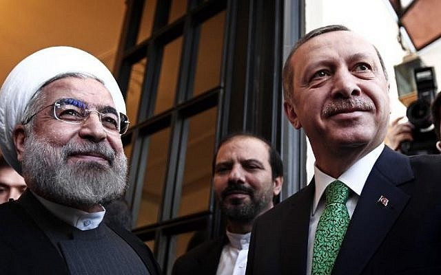 Iranian President Hassan Rouhani, left, with Turkish Prime Minister Recep Tayyip Erdogan in Tehran, in January (photo credit: Behrouz Mehri/AFP)