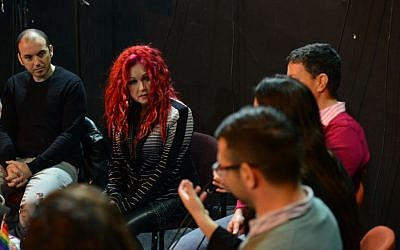 Lauper listening to the activists. (photo credit: courtesy image)