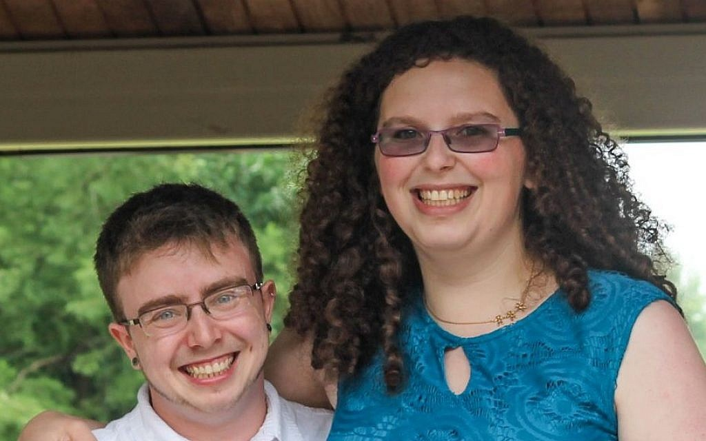 Dane Kutler and Rowan Parker celebrating at one of their 10 wedding ceremonies in 2013. (photo credit: JTA)