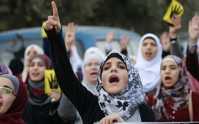 Jordanian women shout slogans as they protest in Amman on January 25, 2014 (photo credit: AFP/File/ Khalil Mazraawi)