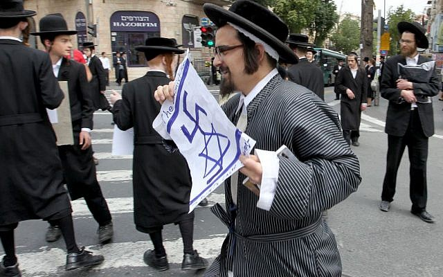 A member of the extreme anti-Zionist Naturei Karta ultra-Orthodox sect in the Meah Shearim neighborhood in Jerusalem. May 2 2011. (Photo credit: Nati Shohat/Flash90)