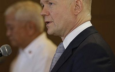 British Foreign Secretary William Hague answers questions from the media during a joint news conference with his Philippine counterpart Albert del Rosario, left, Thursday, Jan. 30, 2014 in Manila, Philippines. (photo credit: AP Photo/Bullit Marquez)