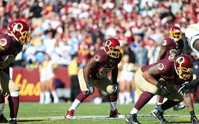 London Fletcher at middle linebacker for the Washington Redskins, for whom he played seven of his 16 NFL seasons. (photo credit: Courtesy Washington Redskins)