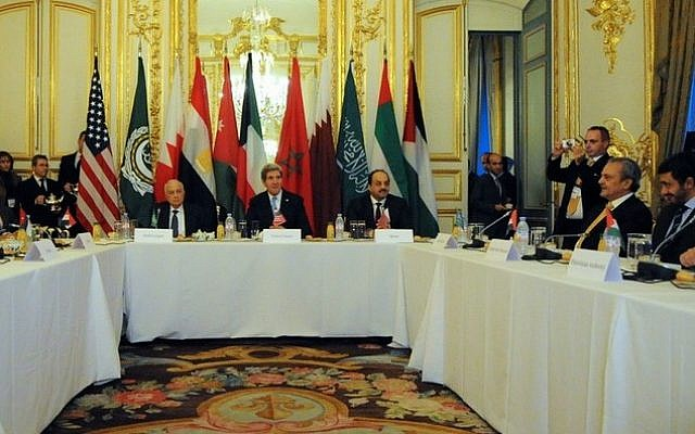 US Secretary of State John Kerry (center) at a meeting with Arab leaders in Paris, on January 12, 2014 (photo credit: US State Department official)