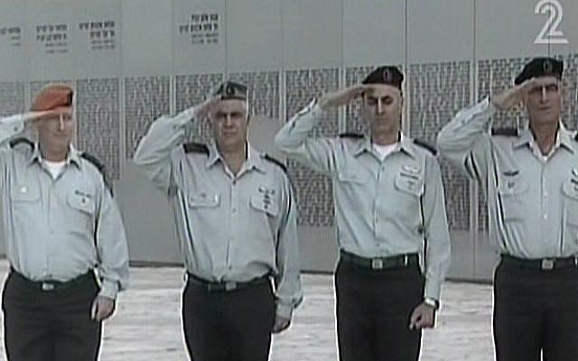 IDF major generals salute the casket of former premier Ariel Sharon, January 13, 2014. (photo credit: screen shot/Channel 2)