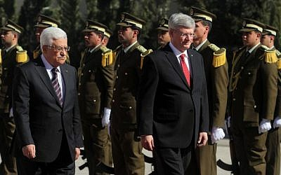 Canadian Prime Minister Stephen Harper and Palestinian Authority President Mahmoud Abbas walking past Palestinian guards,  January 20, 2014 (photo credit: Issam Rimawi/Flash90)