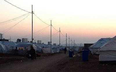 Sun sets behind a refugee camp in Iraqi Kurdistan (photo credit: Times of Israel/Lazar Berman)
