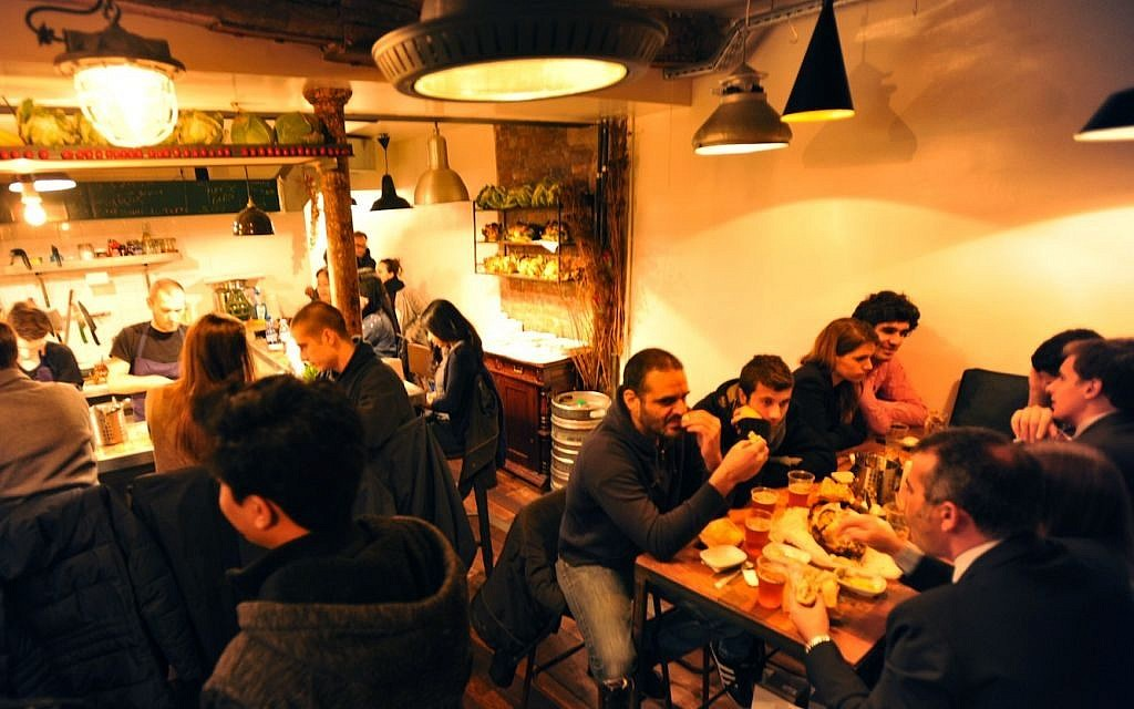 The Paris outpost of the Tel Aviv restaurant Miznon serves fusion dishes of Israeli and French cuisine in a pita. (photo credit: Cnaan Liphshiz/JTA)