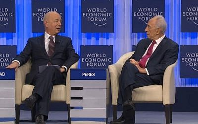 President Shimon Peres speaking to WEF founder Klaus Schwab in Davos. (screen capture: WEF)