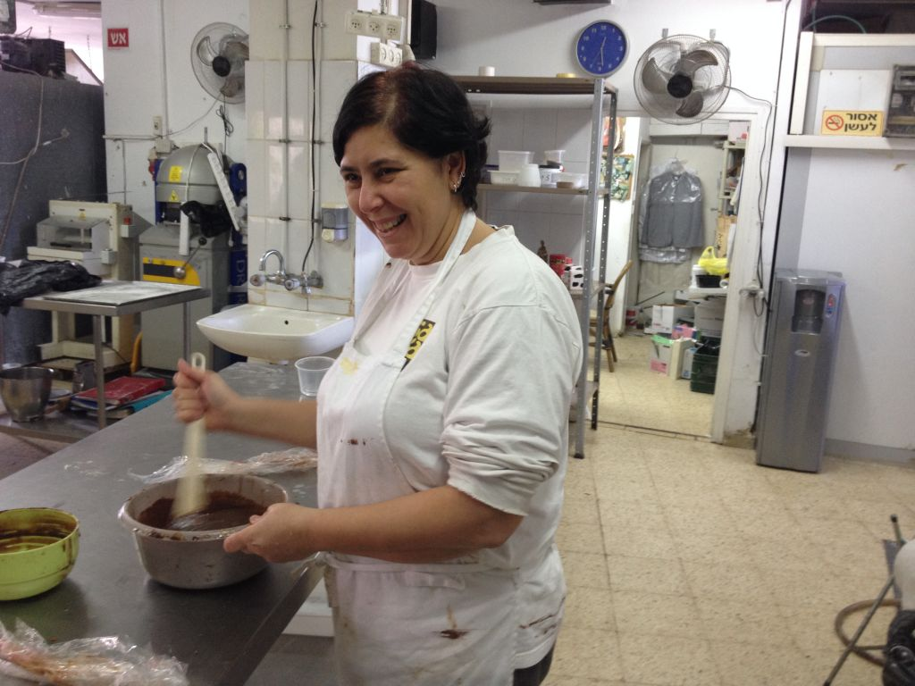 Galia Bertele working in her kitchen (photo credit: Jessica Steinberg/Times of Israel)