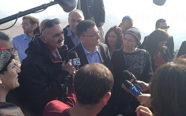 Interior Minister Gideon Sa'ar, flanked by MKs and deputy ministers, addresses reporters at the Yigal Allon lookout over the Jordan Valley, Thursday, January 2, 2014 (photo credit: Raphael Ahren/Times of Israel)