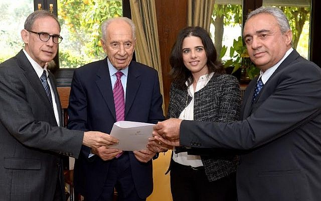 President Peres, flanked by MKs Nachman Shai and Ayelet Shaked, accepts a Knesset petition on behalf of Jonathan Pollard in 2014 (photo credit: Haim Zach, GPO)