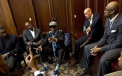Dennis Rodman, center, speaks with fellow US basketball players during a team meeting at a Pyongyang, North Korea hotel, on Tuesday (photo credit: AP/David Guttenfelder)