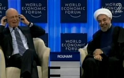 Iranian president Hassan Rouhani laughs after he is asked at the Davos forum if he would reach out with all countries in the region (screen capture: Channel 2)