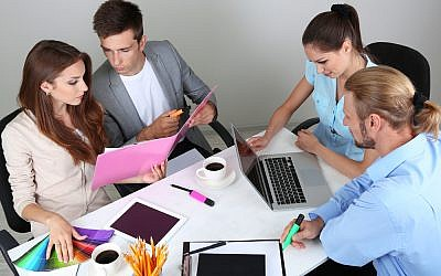Marketing team (Marketing team image via Shutterstock)