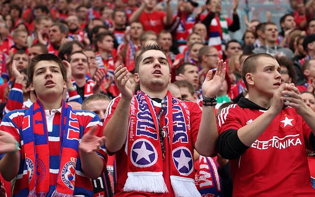 Soccer fans at a match in Krakow, Poland on October 6, 2013. (
