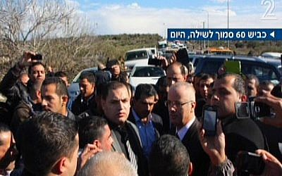 PA Prime Minister Rami Hamdallah, center right, after his convoy was pulled over by Israeli police for speeding, Tuesday, January 14, 2014 (screen capture: Channel 2)