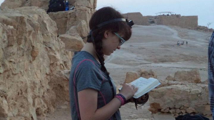 Avigayil Halpern prays for the first time with tefillin at Masada, summer 2013. (photo credit: Courtesy)