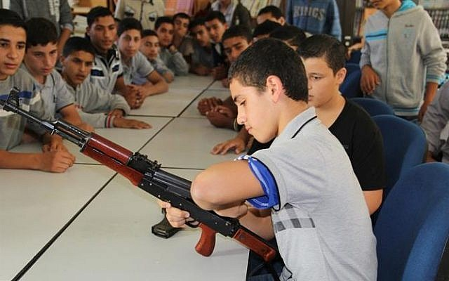 A child practices disassembling an AK-47 during the Hamas-run 'pioneers of liberation' camps in Gaza (photo credit: Hamas interior ministry website)