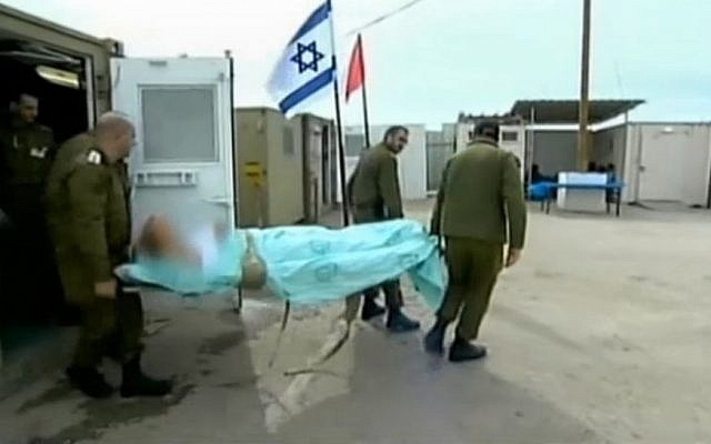 Israeli soldiers escort a wounded Syrian patient into a secret military field hospital in the Golan Heights. (photo credit: screen capture, Channel 2)