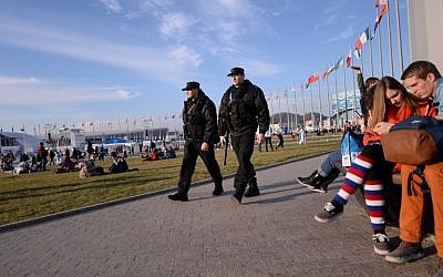 Security guards patrol in the Olympic park during the Sochi winter Olympics, Friday, February 14, 2014 (photo credit: AFP/Andrej Isakovic)