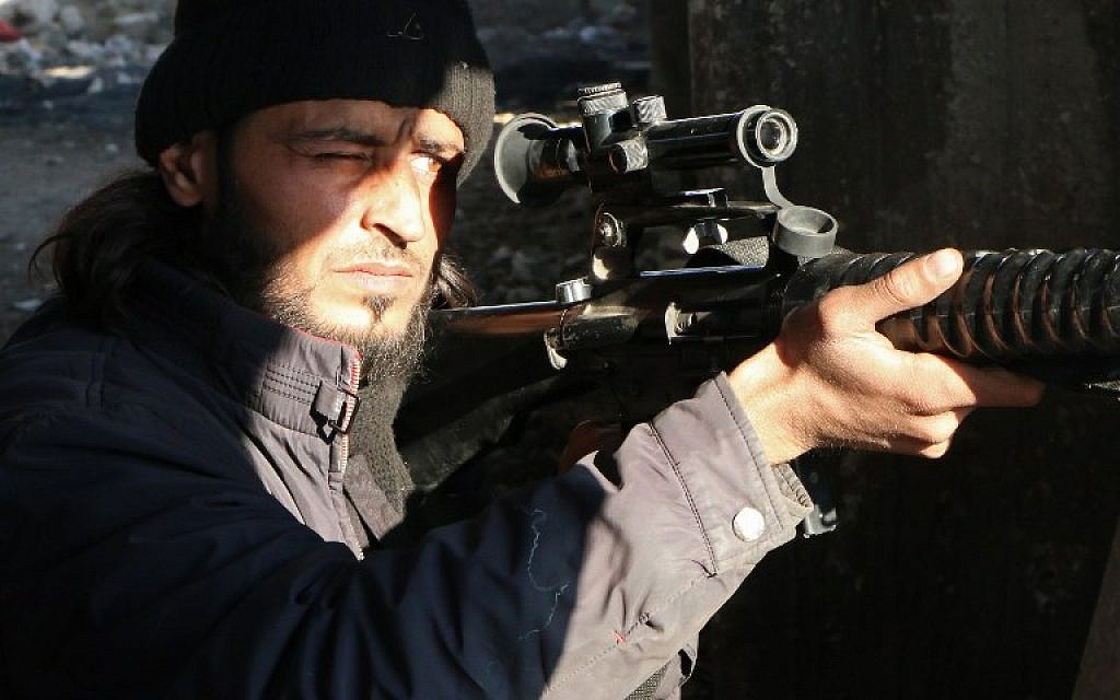 A rebel fighter scans the area with the scope of his rifle as he holds a position in the northern Syrian city of Aleppo on February 11, 2014 (photo credit: AFP/Aleppo Media Center/Fadi al-Halabi)