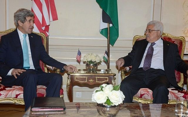 US Secretary of State John Kerry, left, meets with Palestinian Authority President Mahmoud Abbas in Paris last Thursday (photo credit: The Palestinian Presidency/Thaer Ghanaim/AFP)