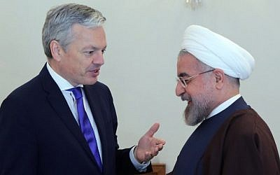 Iranian President Hassan Rouhani (R) welcomes Belgian Foreign Minister Didier Reynders in Tehran on February 23, 2014. (photo credit: AFP photo/Atta Kenare)