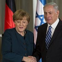 German Chancellor Angela Merkel (left) shakes hands with Prime Minister Benjamin Netanyahu after arriving in Jerusalem on February 24, 2014. (Sebastian Scheiner/AFP)