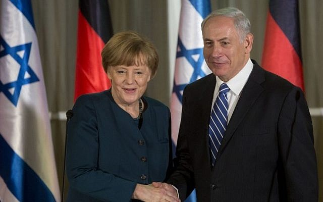 German Chancellor Angela Merkel shakes hands with Prime Minister Benjamin Netanyahu after arriving in Jerusalem on Monday, February 24, 2014.  (photo credit: Sebastian Scheiner/AFP)